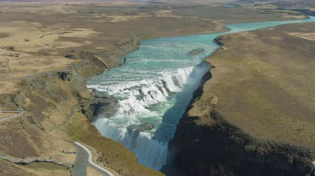 tilt down : Gullfoss Waterfall on Summer Sunny Day. Landscape of Iceland. Aerial View. Drone Flies Upwards, Tilt Down