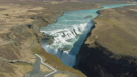 gullfoss : Gullfoss Waterfall on Summer Day. Iceland. Aerial View. Drone Flies Downwards, Tilt Up Stock Footage