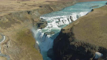 tilt down : Gullfoss Waterfall on Summer Sunny Day. Iceland. Aerial View. Drone Flies Forward, Tilt Down Stock Footage