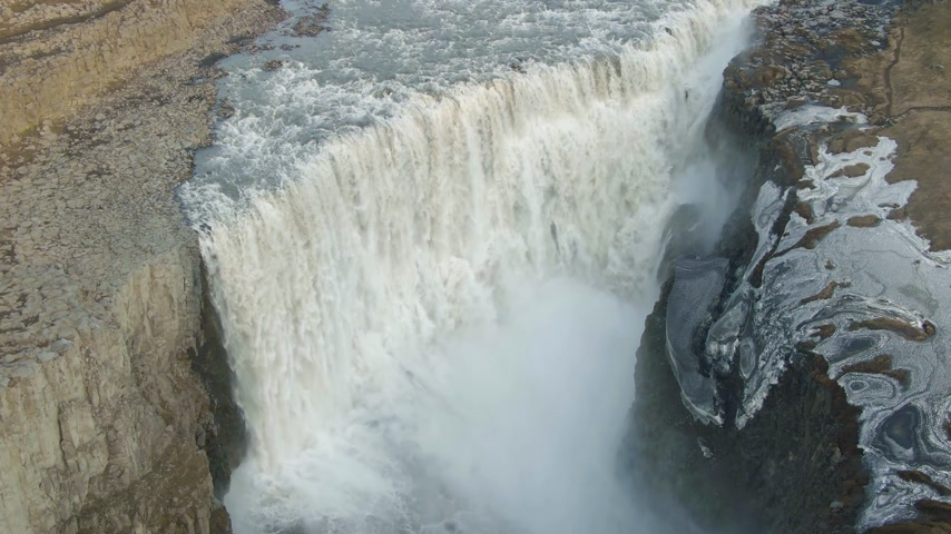 downwards : Dettifoss Waterfall in Summer Evening. Iceland. Aerial View. Drone Flies Downwards, Tilt Up Stock Footage