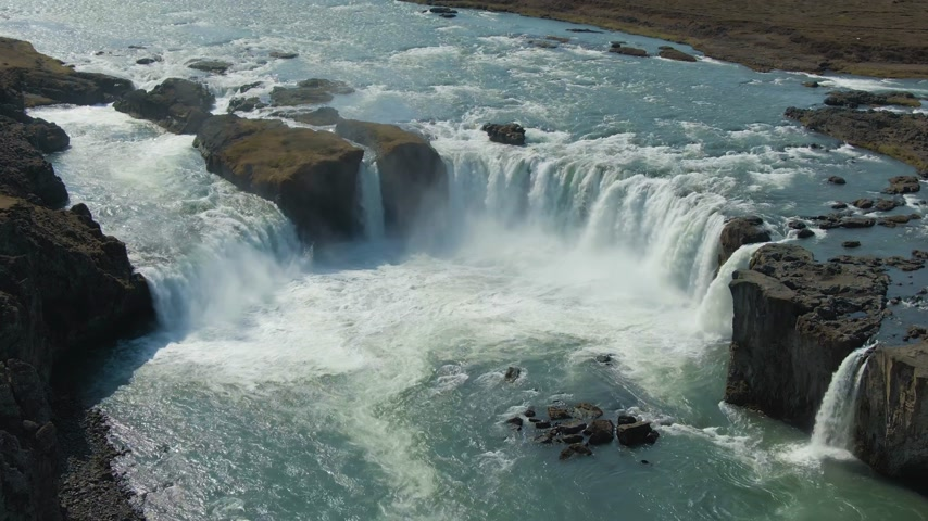 downwards : Godafoss Waterfall in Summer Sunny Day. Iceland. Aerial View. Drone Flies Downwards, Tilt Up