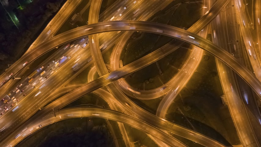 upward : Complex Road Intersection and Cars Traffic at Night. Flyover. Aerial Vertical Top-Down Hyper Lapse. Drone Flies Upwards