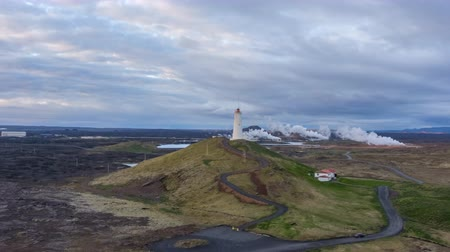 geotermální : Reykjanes Lighthouse in Geothermal Area. Iceland. Aerial Hyper Lapse. Drone is Orbiting