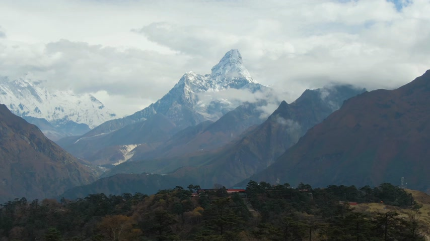 Ama Dablam Mountain and Coniferous Forest. Himalaya, Nepal. Aerial View. Drone Flies Backwards