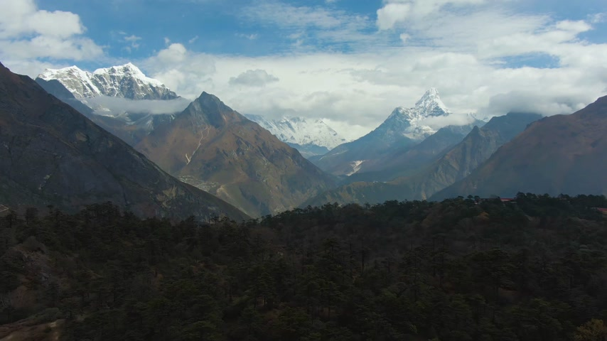 Ama Dablam and Taboche Mountains. Khumbu Valley. Himalaya, Nepal. Aerial View. Drone Flies Backwards