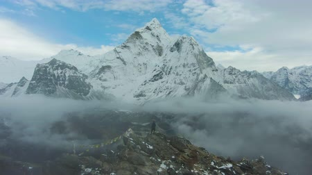 Man Looking on Ama Dablam Mountain. Himalaya, Nepal. Aerial View. Drone Flies Forward