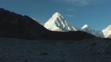 tampado : Pumori and Lingtren Mountains. Himalaya, Nepal. Aerial View. Drone Flies Backwards