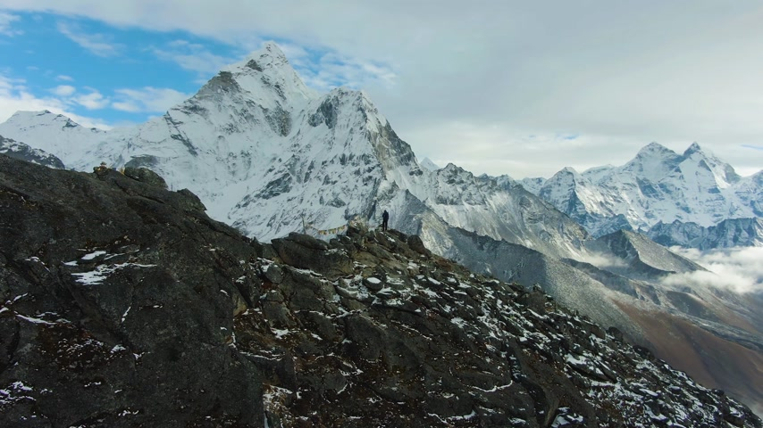 Hiker Man and Ama Dablam Mountain. Himalaya, Nepal. Aerial View. Drone is Orbiting