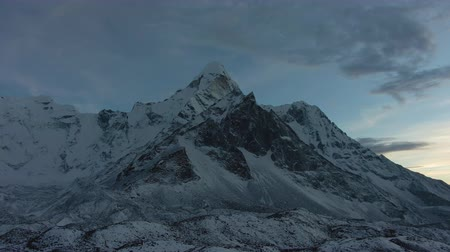 Ama Dablam Mountain at Sunset near Chukhung. Himalaya, Nepal. Aerial View. Drone Flies Sideways and Upwards