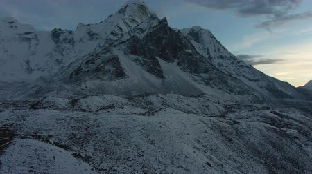 Ama Dablam Mountain at Sunset. Himalaya, Nepal. Aerial View. Drone Flies Sideways, Tilt Up. Reveal Shot