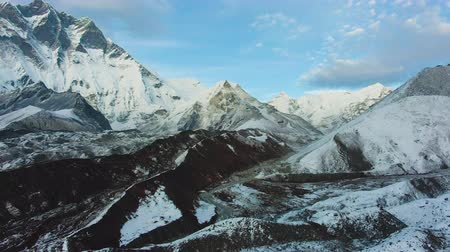 Island Peak Mountain and Lhotse South Face at Sunset. Aerial View. Drone Flies Forward