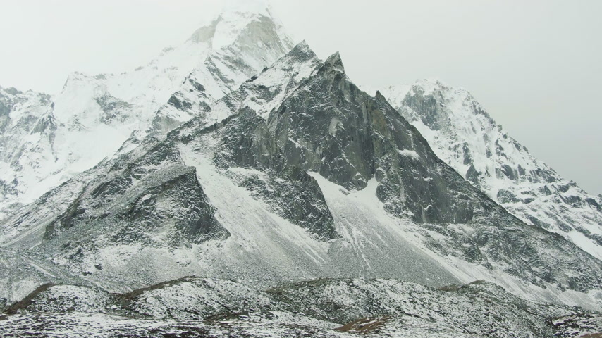 Ama Dablam Mountain. Himalaya, Nepal. Aerial View. Drone Flies Sideways, Tilt Up. Reveal Shot