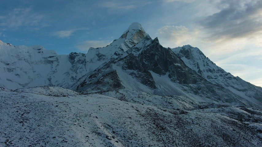 Ama Dablam Mountain at Sunset near Chukhung. Himalaya, Nepal. Aerial View. Drone Flies Forward