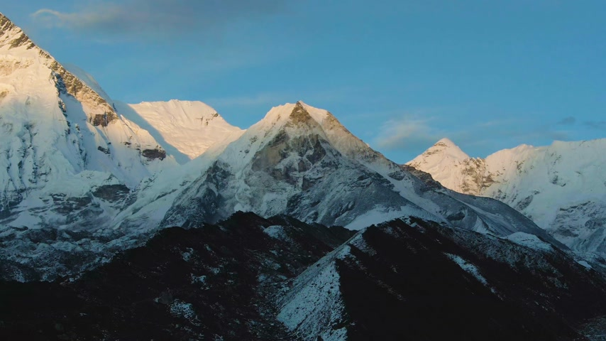 Island Peak Mountain at Sunset. Aerial View. Drone Flies Forward