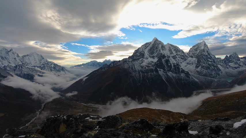 Taboche and Cholatse Mountains at Sunset. Himalaya, Nepal. Timelapse