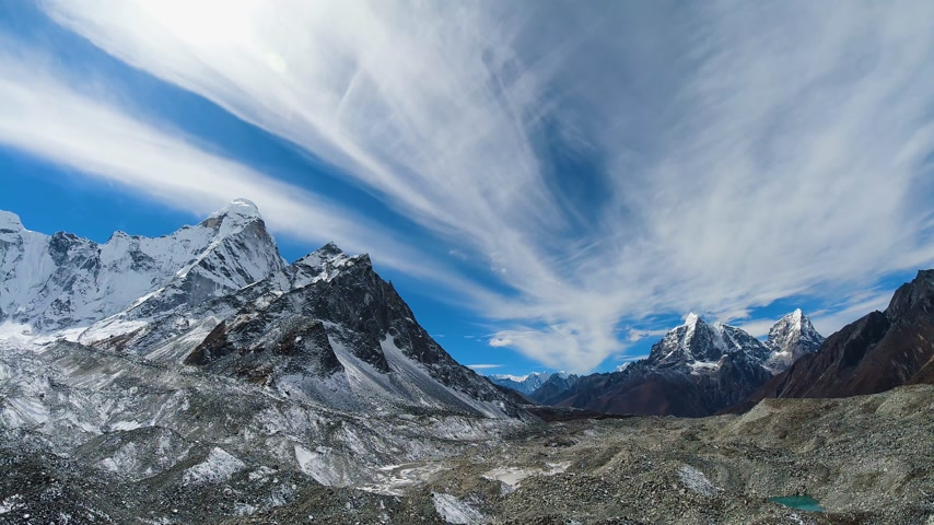 Ama Dablam, Cholatse and Taboche Mountains at Sunny Day. Blue Sky with Clouds. Himalaya, Nepal. Time Lapse