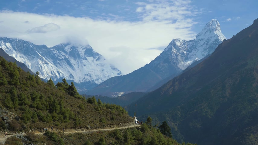 himalayan : Ama Dablam Mountain and Hikers at Sunny Day. Himalaya, Nepal Stock Footage