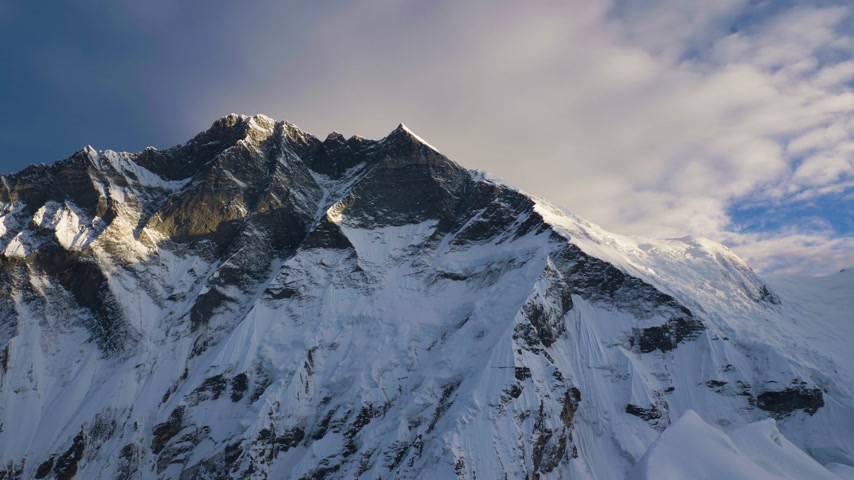 Lhotse South Face at Sunrise. View from Top of Island Peak. Himalaya Mountains, Nepal. Medium Panning Shot