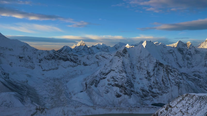 Himalaya at Sunrise. View from Top of Island Peak Mountain. Nepal. Wide Panning Shot