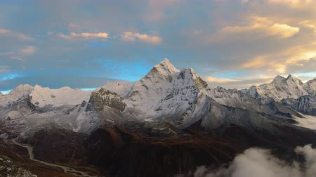 Ama Dablam Mountain at Sunset. Himalaya, Nepal. Timelapse at Sunset