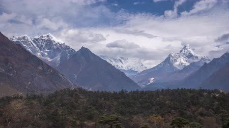 Ama Dablam and Taboche Mountains on Sunny Day. Blue Sky. Himalaya, Nepal. Timelapse