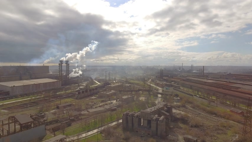 producing energy : Aerial view of industrial steel plant. Aerial sleel factory. Flying over smoke steel plant pipes. Environmental pollution. Smoke. Stock Footage