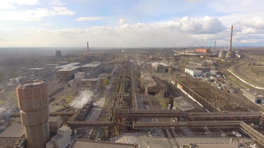 powerplant : Aerial view of industrial steel plant. Aerial sleel factory. Flying over smoke steel plant pipes. Environmental pollution. Smoke. Stock Footage