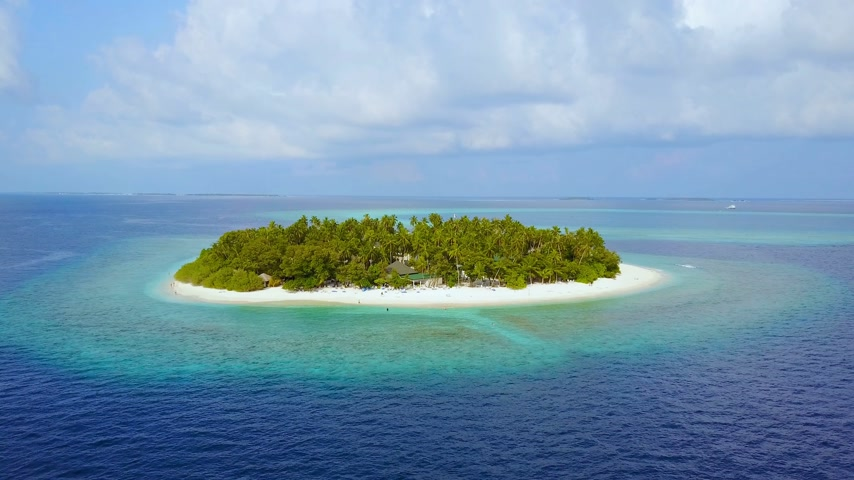 над : Island in the sea. Maldives white sand beach tropical islands with drone aerial flying birds eye view with aqua blue sea water and sunny sky