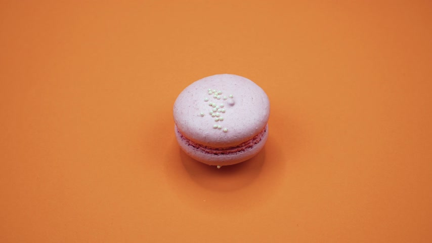 acıbadem kurabiyesi : ROTATION: A Colorful Macaroons are rotating on a orange background Stok Video