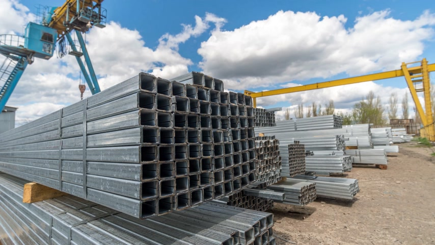 kaplanmış : Metallic, steel or aluminum rectangular pipes and tubes on warehouse. Time lapse. Moving clouds Stok Video