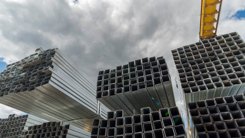 nesnelerin grubu : Metallic, steel or aluminum rectangular pipes and tubes on warehouse. Time lapse. Moving clouds Stok Video