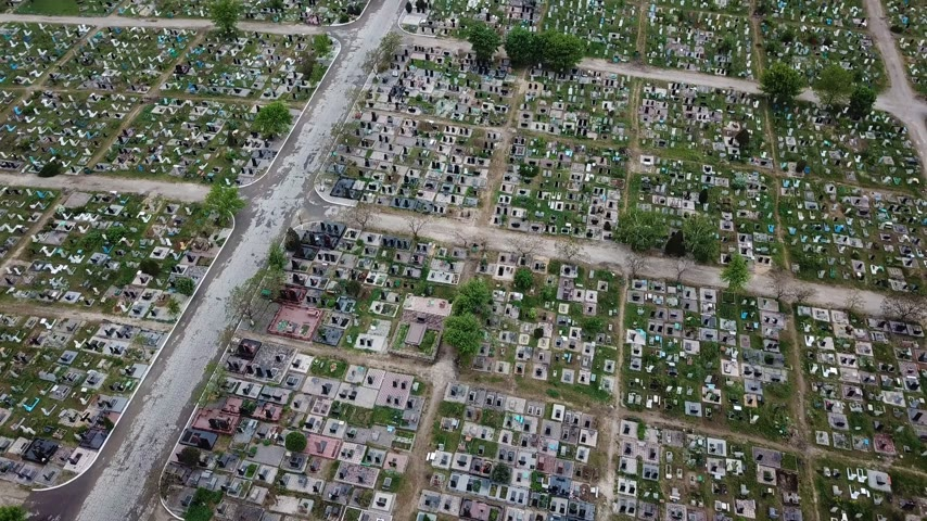 headstone : An aerial over a vast cemetery of headstones honors veterans