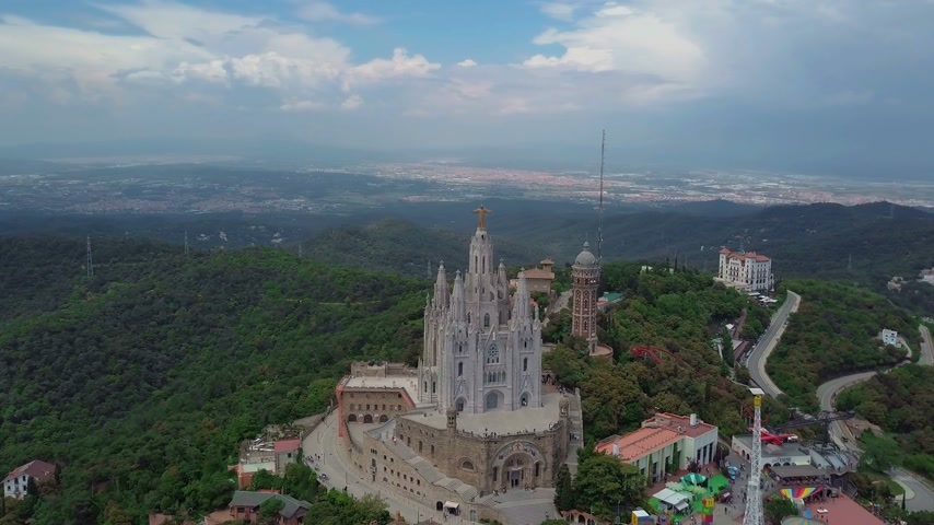 pilgrimage : Aerial view of tibidabo monument and amusement park Stock Footage