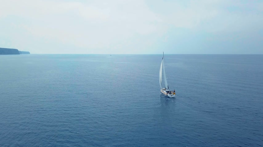 マスト : Yacht sailing on opened sea. Sailing boat. Yacht from drone. Yachting video. Yacht from above. Sailboat from drone. Sailing video. Yachting at windy day. Yacht. Sailboat. 動画素材