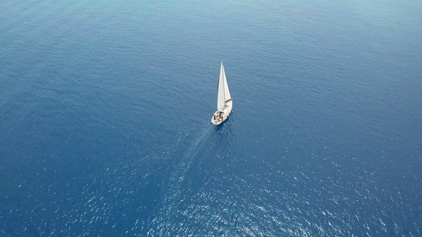 vela : Yacht sailing on opened sea. Sailing boat. Yacht from drone. Yachting video. Yacht from above. Sailboat from drone. Sailing video. Yachting at windy day. Yacht. Sailboat. Stock Footage