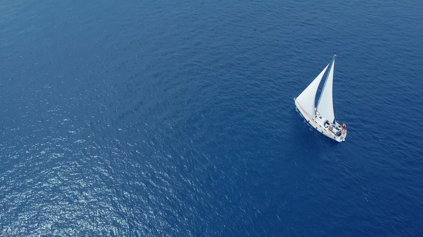 yelkencilik : Yacht sailing on opened sea. Sailing boat. Yacht from drone. Yachting video. Yacht from above. Sailboat from drone. Sailing video. Yachting at windy day. Yacht. Sailboat. Stok Video