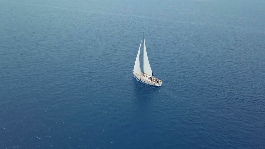 yatçılık : Yacht sailing on opened sea. Sailing boat. Yacht from drone. Yachting video. Yacht from above. Sailboat from drone. Sailing video. Yachting at windy day. Yacht. Sailboat. Stok Video