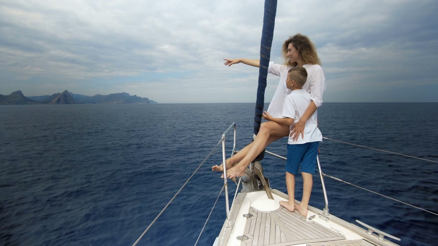 voyager : Freedom of the ocean for healthy family on outdoor Summer vacation sailing on luxury yacht. Mother and son