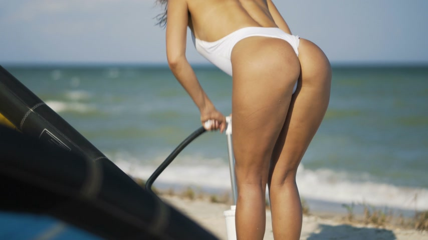 pipa : A young girl blows a kite. Beautiful ass in swimsuit