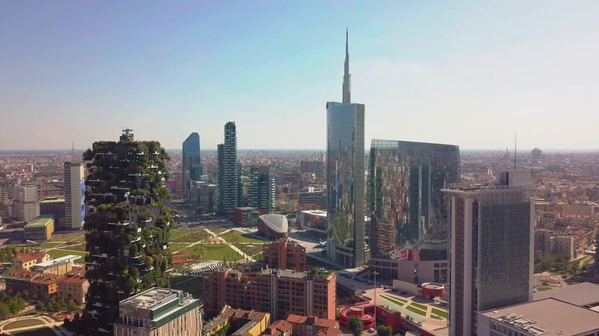 metropolitano : milan city skyline aerial view flying towards financial area skyscrapers