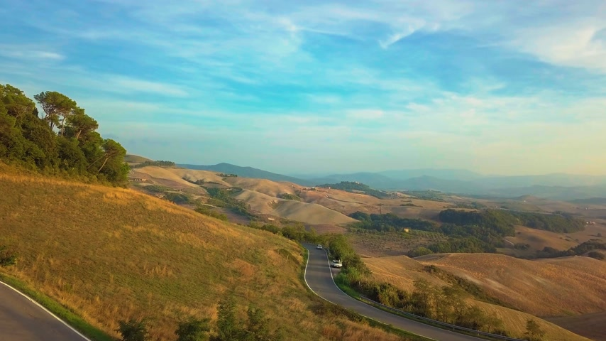 toscana : Aerial nature landscape beautiful hills forests fields and vineyards of Tuscany, Italy Stock Footage