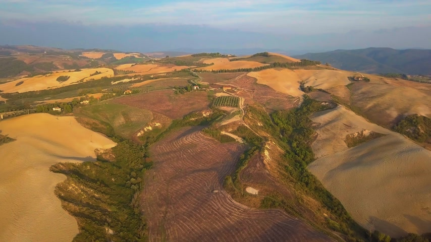 wschód słońca : Aerial nature landscape beautiful hills forests fields and vineyards of Tuscany, Italy Wideo