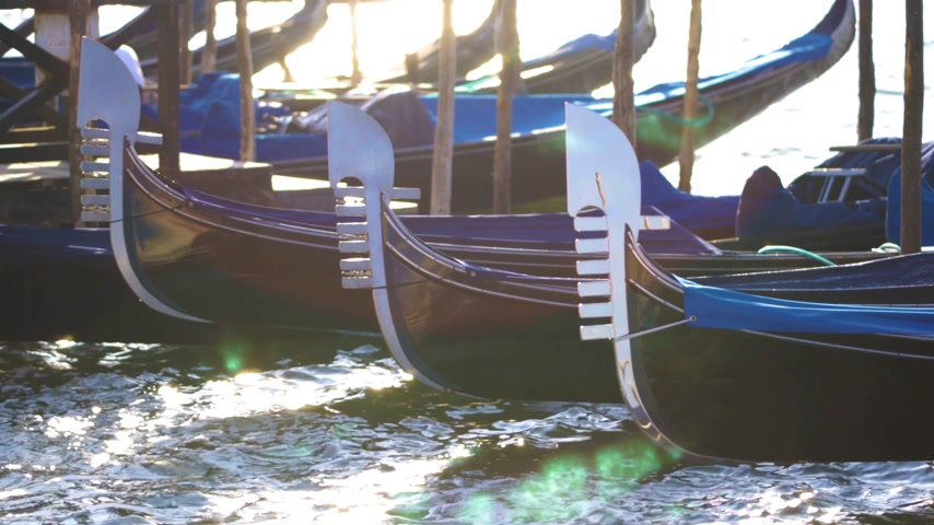 venetian lagoon : Beautiful sunny day blue sky in Venice, Italy, with gondolas in the canals Stock Footage