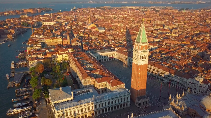 ikonik : aerial orbit over san marco square at sunrise in venice italy