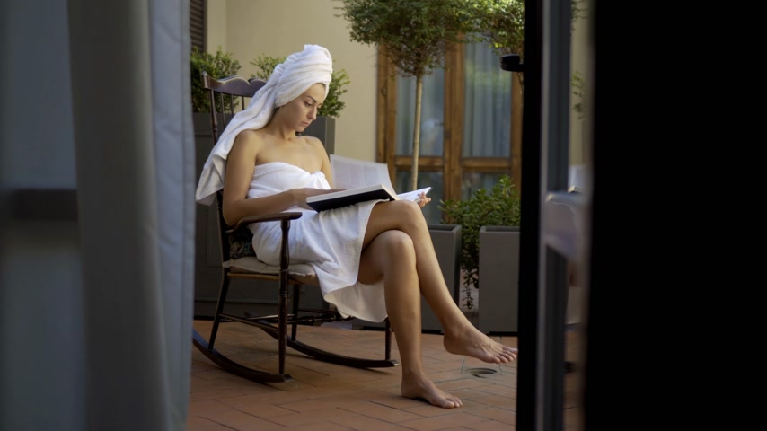 towel white : Woman Reading after Shower in Bathrobe