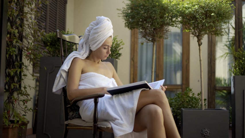 towel : Woman Reading after Shower in Bathrobe