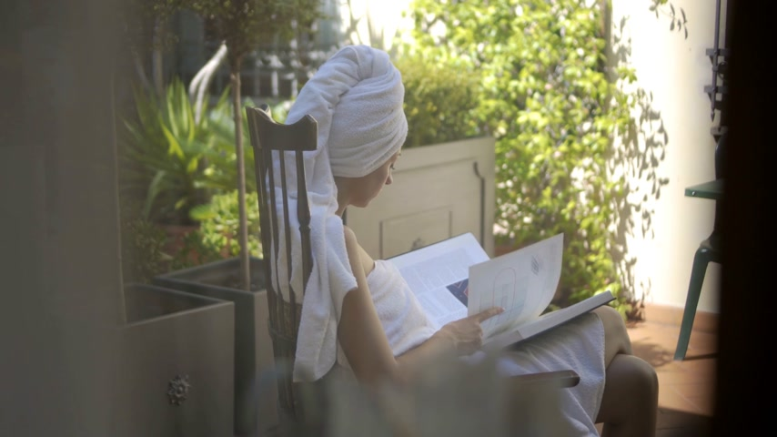 shower room : Woman Reading after Shower in Bathrobe