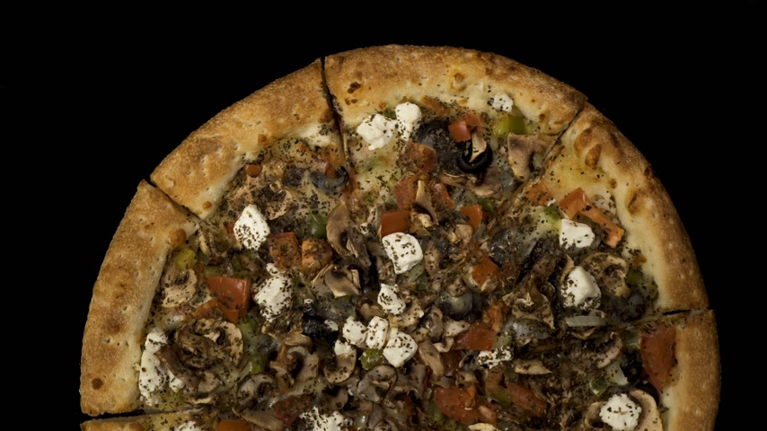diablo : Rotating pizza with smoked sausage and olives on a black background. Top view center orientation Stock Footage