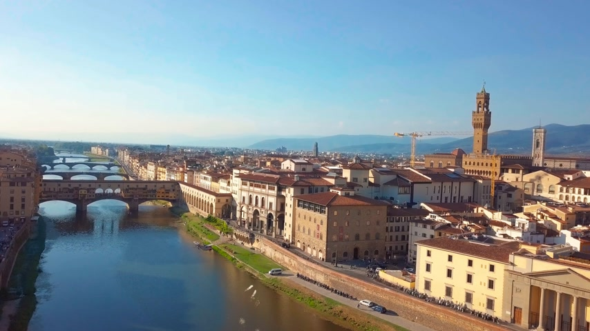arno : Aerial view. Florence Ponte Vecchio Bridge and City Skyline in Italy. Florence is capital city of the Italian region Tuscany. Stock Footage