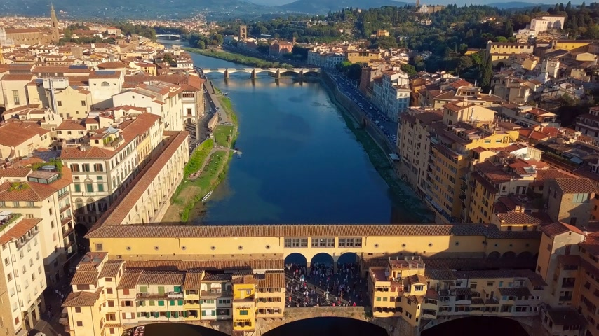 vecchio : Aerial view. Florence Ponte Vecchio Bridge and City Skyline in Italy. Florence is capital city of the Italian region Tuscany. Stock Footage
